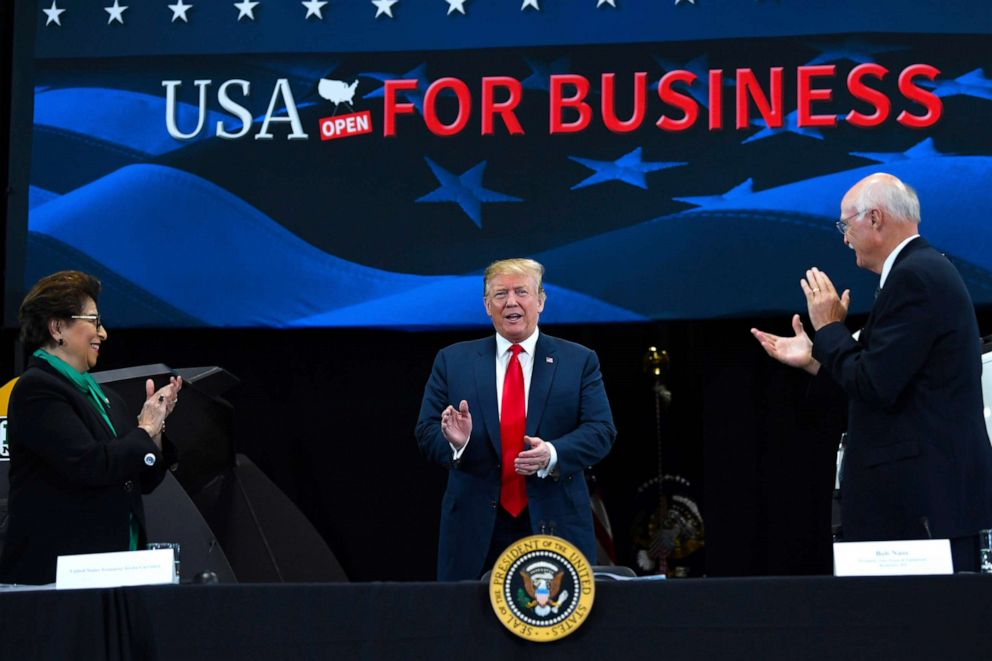 PHOTO: President Donald Trump, center, arrives to speak at Nuss Truck and Equipment in Burnsville, Minn., Monday, April 15, 2019, during an event to tout the 2017 tax law.