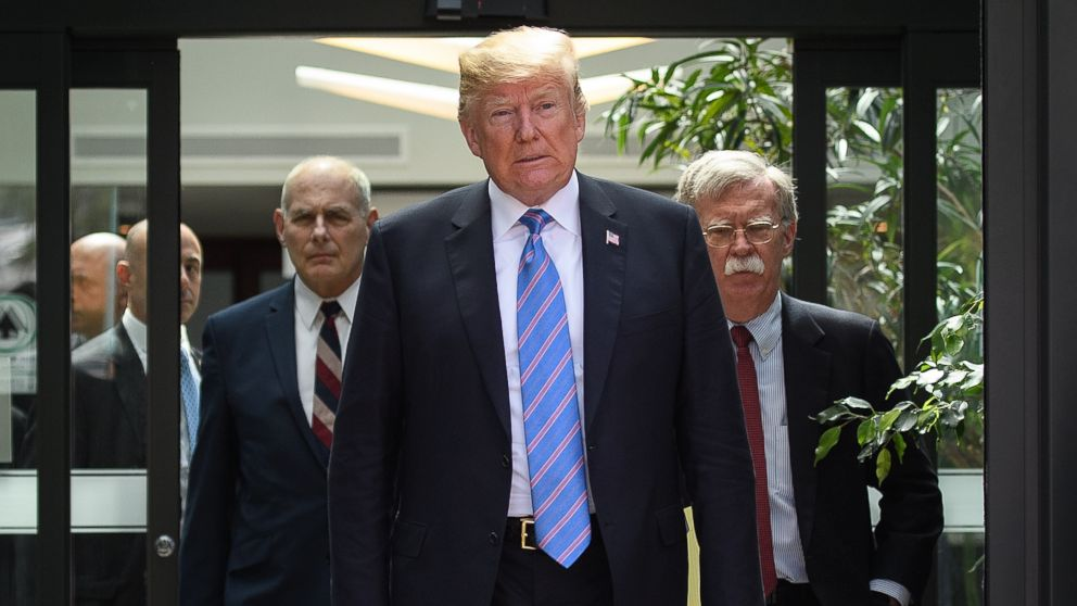Donald Trump leaves with Chief of Staff John Kelly and National Security Advisor John Bolton after holding a press conference, June 9, 2018 ,in La Malbaie, Canada.