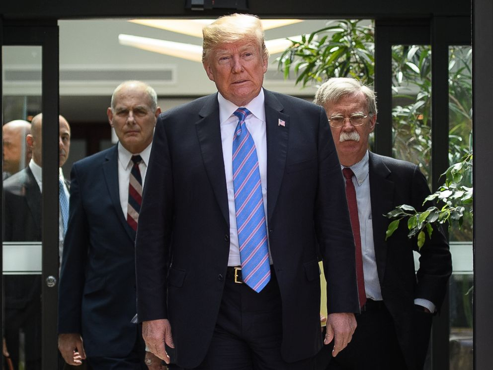 PHOTO: Donald Trump leaves with Chief of Staff John Kelly and National Security Advisor John Bolton after holding a press conference, June 9, 2018 ,in La Malbaie, Canada.
