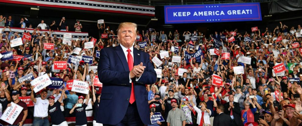 "PHOTO: US President Donald Trump salutes his supporters after a ""Keep America Great"" campaign rally at the SNHU Arena in Manchester, New Hampshire, on August 15, 2019."