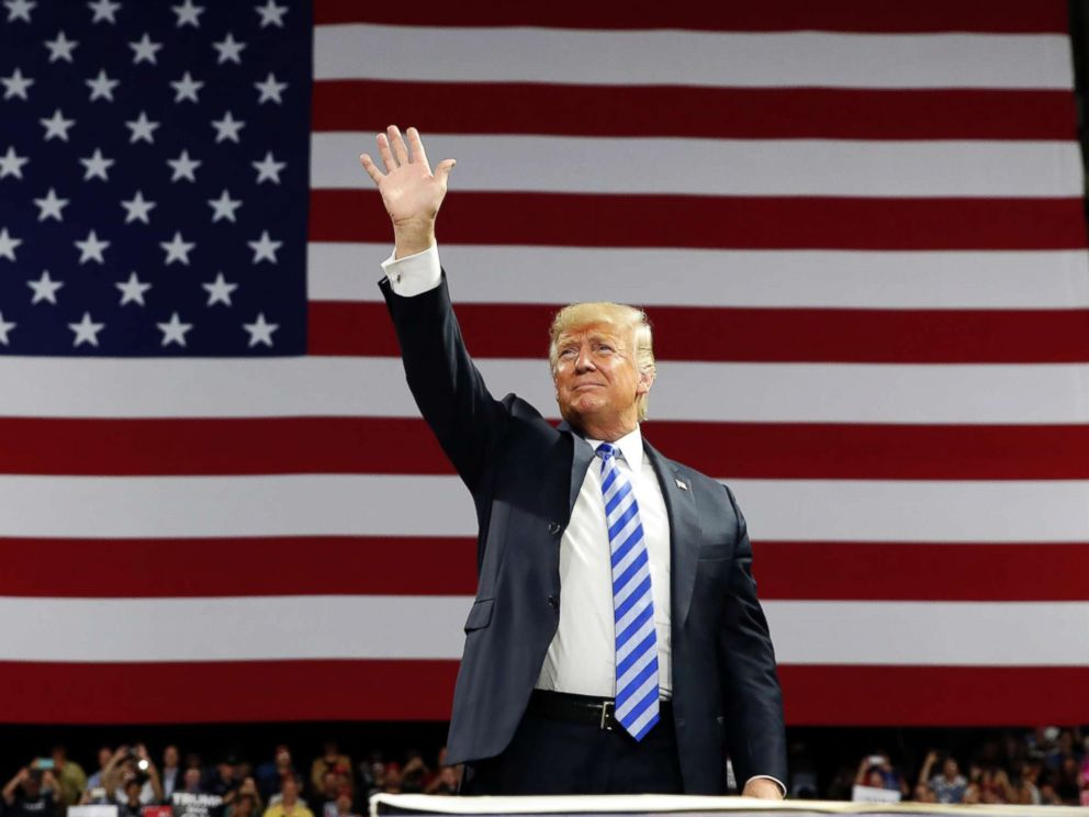PHOTO: Donald Trump waves as he arrives to speak during a rally, Aug. 21, 2018, in Charleston, W.Va.