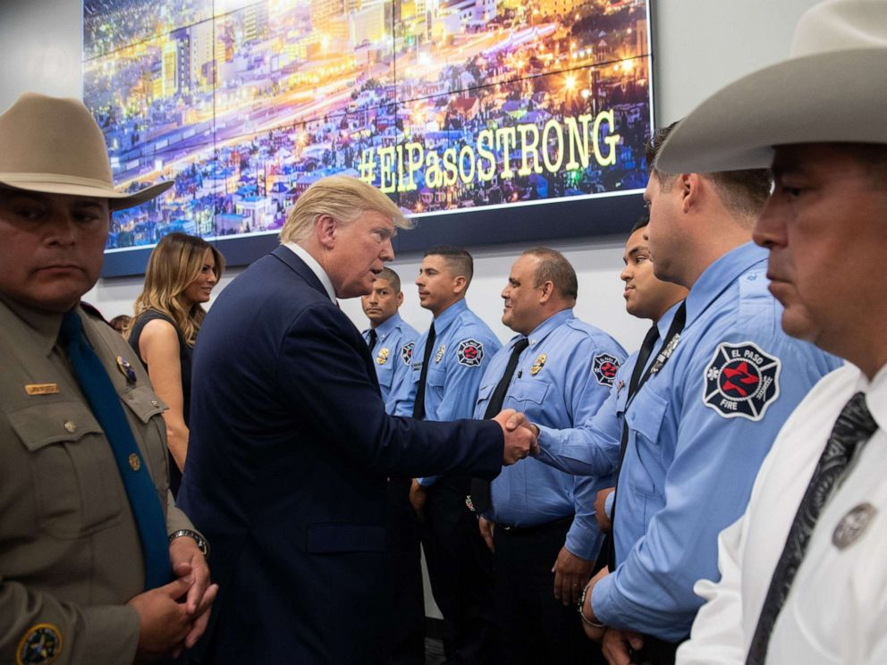 PHOTO: US President Donald Trump greets first responders as he visits El Paso Regional Communications Center in El Paso, Texas, August 7, 2019.