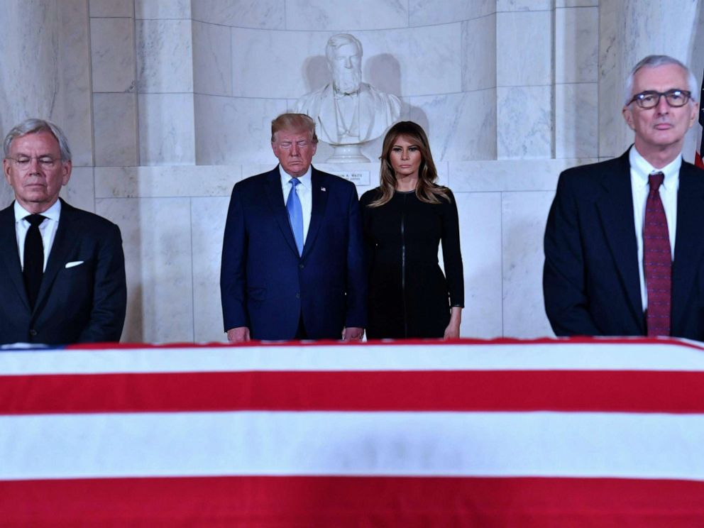 PHOTO: President Donald Trump and first lady Melania Trump pay their respects before the flag-draped casket of late Supreme Court Justice John Paul Stevens in the Great Hall of the Supreme Court in Washington D.C., July 22, 2019.