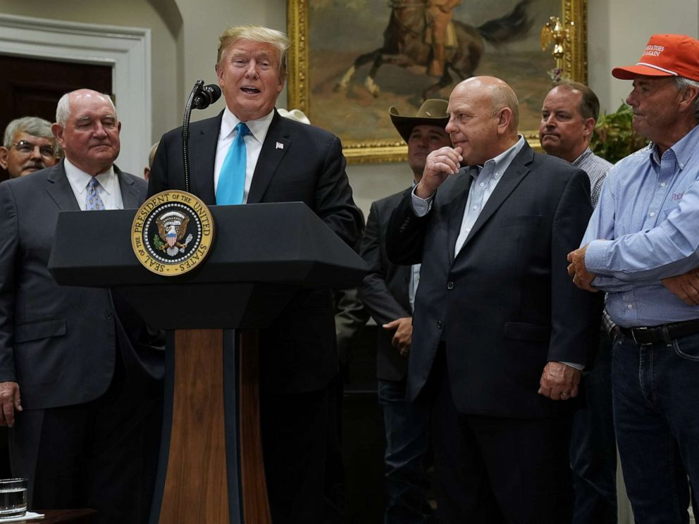 PHOTO: President Donald Trump delivers remarks in support of farmers and ranchers with Agriculture Secretary Sonny Perdue (2nd L) in the Roosevelt Room at the White House, May 23, 2019.