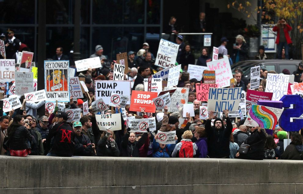PHOTO: Demonstrators stage a protest across the river from Trump International Hotel and Tower while President Donald Trump visits in Chicago, Oct. 28, 2019.