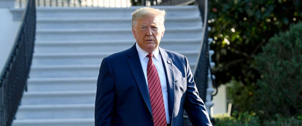 PHOTO:President Donald Trump walks over to talk with reporters on the South Lawn of the White House, Sept. 22, 2019, as he prepares to board Marine One.