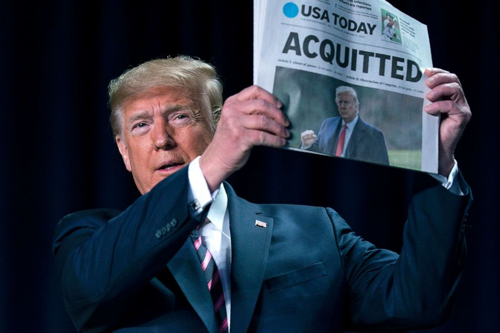 Image result for image, photo, picture, 2020 prayer breakfast, trump holds newspaper