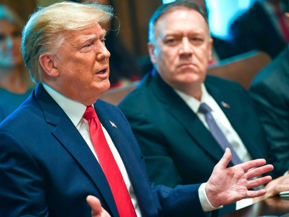 PHOTO: President Donald Trump speaks next to Secretary of State Mike Pompeo during a Cabinet Meeting at the White House, Oct. 21, 2019.