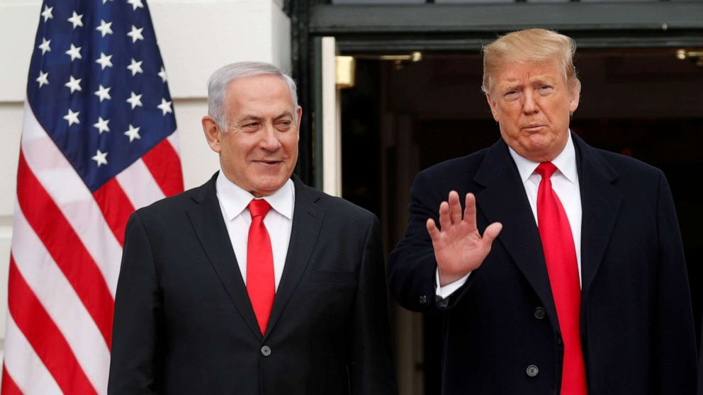 President Donald Trump gestures to gathered news media as he welcomes Israel Prime Minister Benjamin Netanyahu to the White House, March 25, 2019.