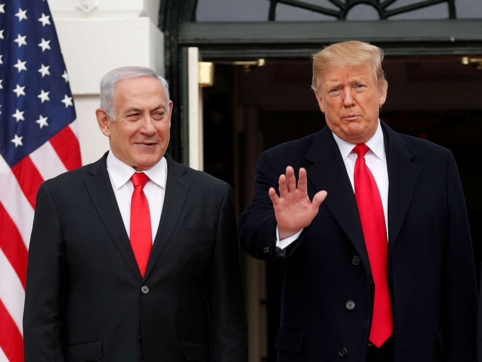 PHOTO: President Donald Trump gestures to gathered news media as he welcomes Israel Prime Minister Benjamin Netanyahu to the White House, March 25, 2019.
