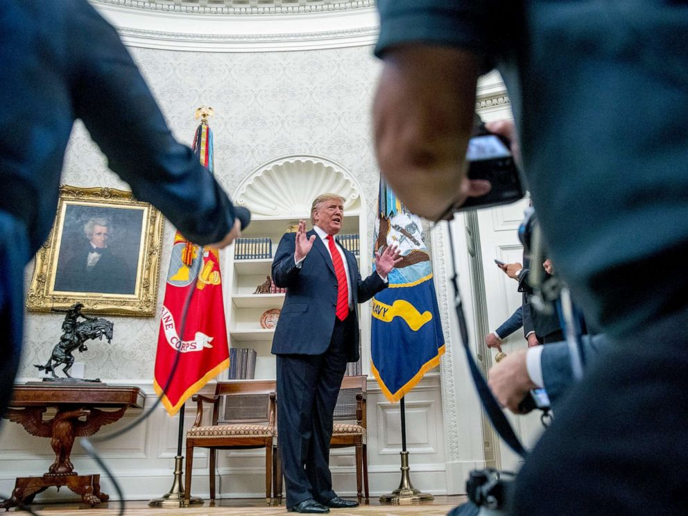 PHOTO: President Donald Trump speaks to member of the media as he departs a ceremonial swearing in ceremony for new Labor Secretary Eugene Scalia in the Oval Office of the White House, Sept. 30, 2019.