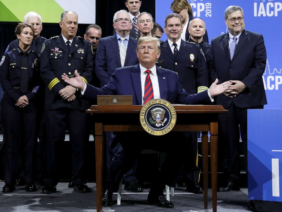 PHOTO: President Donald Trump reacts after signing an executive order during an appearance at the International Association of Chiefs of Police annual conference and expo in Chicago, Oct. 28, 2019.