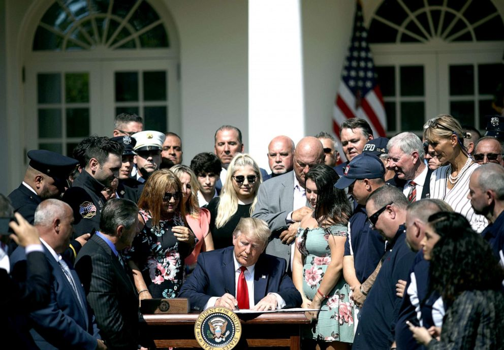 PHOTO: Surrounded by first responders and their families, President Donald Trump signs H.R. 1327, an act to permanently authorize the September 11th victim compensation fund, in the Rose Garden of the White House, July 29, 2019.