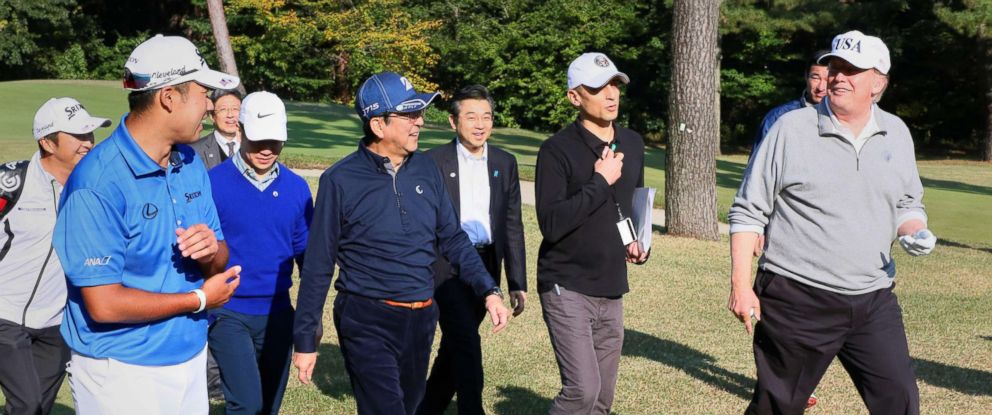 PHOTO: President Donald Trump, right, golfs with Japanese Prime Minister Shinzo Abe, center in blue hat, at Kasumigaseki Country Club in Kawagoe, Saitama Prefecture, Japan, Nov. 5, 2017.
