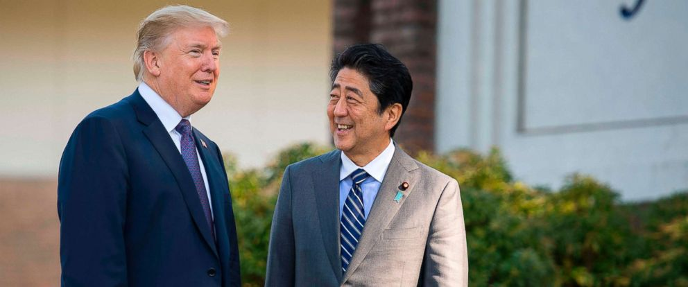 PHOTO: President Donald Trump is greeted by Japans Prime Minister Shinzo Abe, right, upon arrival at the Kasumigaseki Country Club Golf Course in Kawagoe, Saitama, outside Tokyo, Nov. 5, 2017.