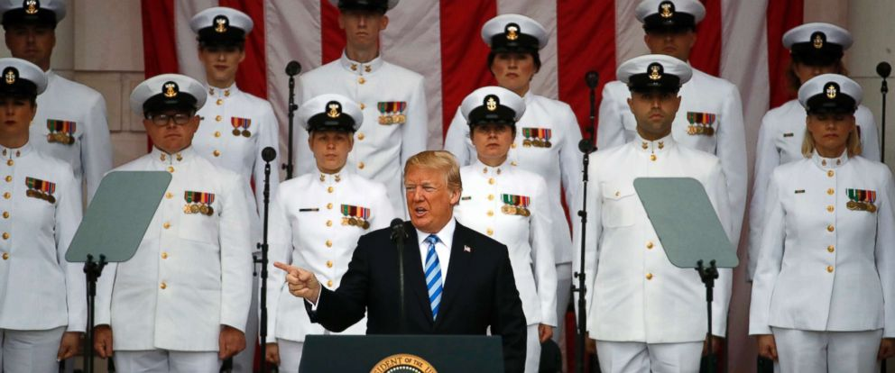 PHOTO: President Donald Trump at the podium as he arrives for a ceremony at the Memorial Amphitheater in Arlington National Cemetery on Memorial Day, May 28, 2018, in Arlington, Va.
