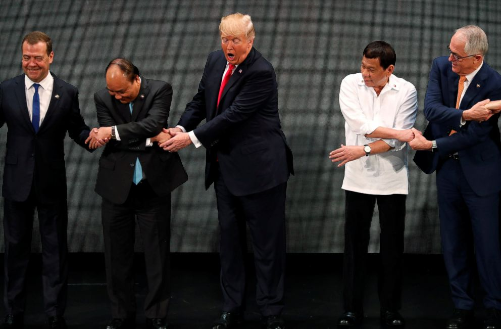 PHOTO: President Donald Trump participates in traditional ASEAN handshake with other leaders at the opening ceremony of the ASEAN Summit in Manila, Philippines, Nov. 13, 2017.
