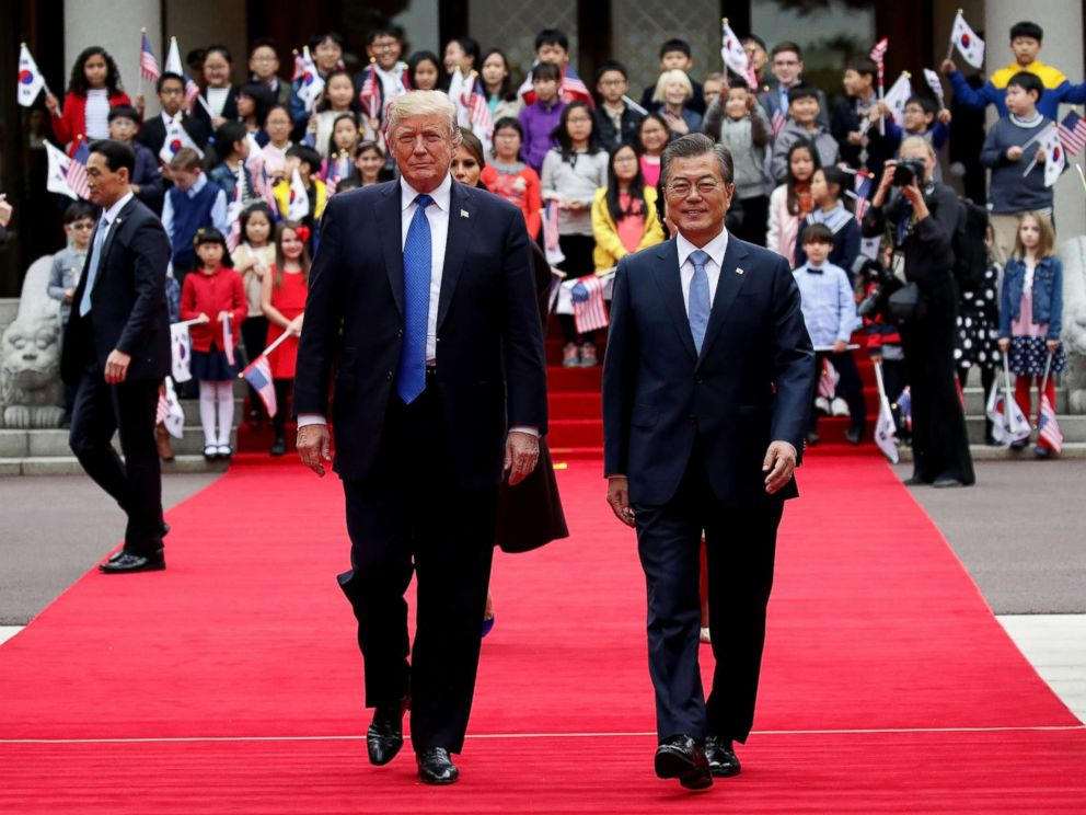 PHOTO: President Donald Trump and South Korean President Moon Jae-In walk towards a guard of honor during a welcoming ceremony at the presidential Blue House, Nov. 7, 2017, in Seoul, South Korea.