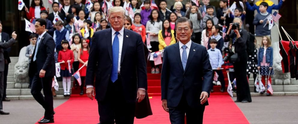 PHOTO: South Korean President Moon Jae-In (R) and President Donald Trump (L) walk towards a guard of honor during a welcoming ceremony at the presidential Blue House, Nov. 7, 2017 in Seoul, South Korea.