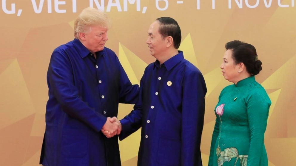 President Donald Trump is welcomed by his Vietnamese counterpart Tran Dai Quang and his wife Nguyen Thi Hien for the gala dinner of the Asia-Pacific Economic Cooperation (APEC) Summit in Da Nang, Vietnam, Nov. 10, 2017.