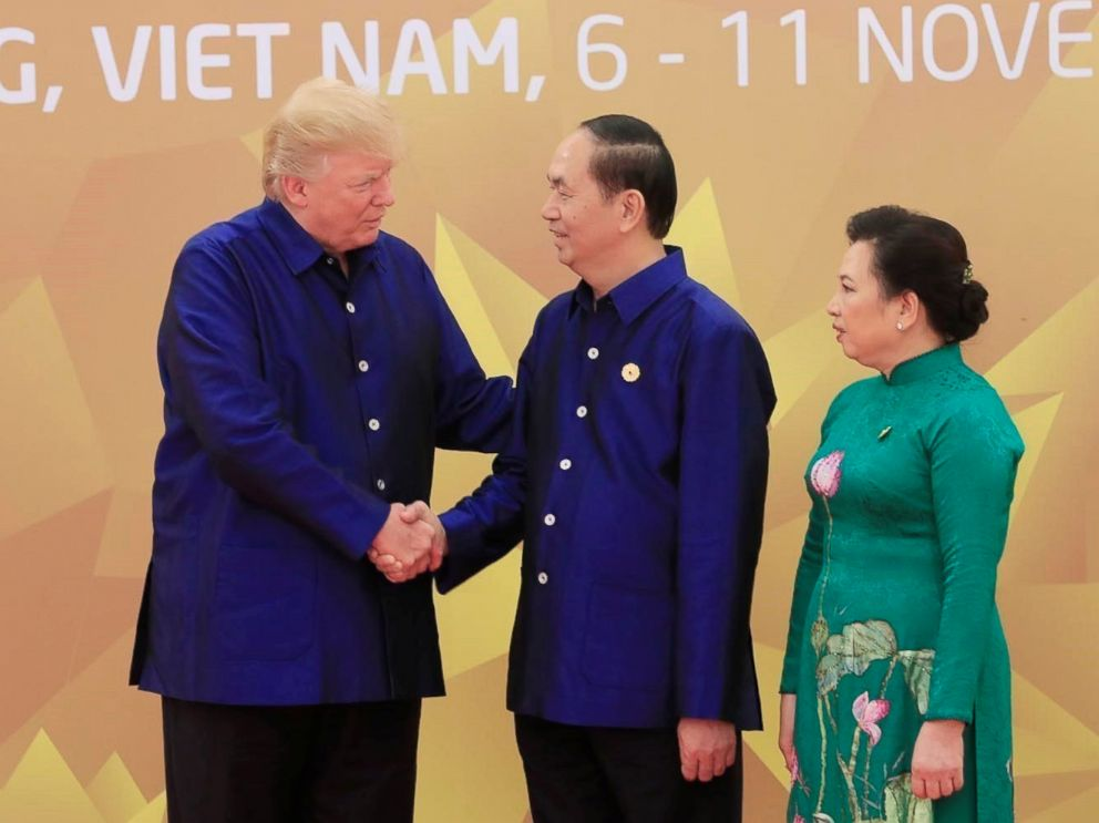 PHOTO: President Donald Trump is welcomed by his Vietnamese counterpart Tran Dai Quang and his wife Nguyen Thi Hien for the gala dinner of the Asia-Pacific Economic Cooperation (APEC) Summit in Da Nang, Vietnam, Nov. 10, 2017.