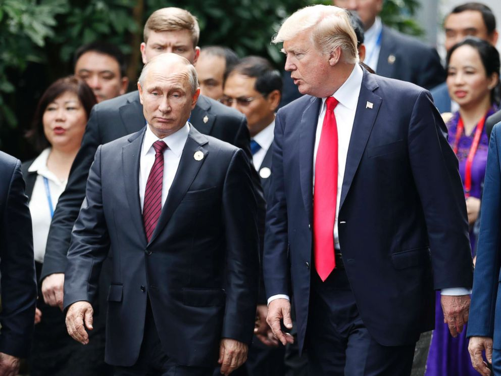 PHOTO: President Donald Trump, right, and Russias President Vladimir Putin talk during the family photo session at the APEC Summit in Danang, Vietnam, Nov. 11, 2017.