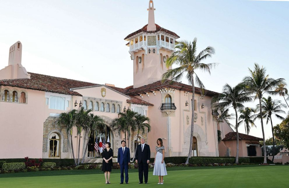 PHOTO: President Donald Trump and First Lady Melania Trump greet Japans Prime Minister Shinzo Abe and wife Akie Abe pose for a photo as they arrive for dinner at Trumps Mar-a-Lago resort in Palm Beach, Fla., April 17, 2018.