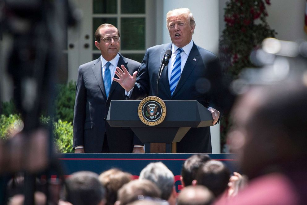 PHOTO: President Donald J. Trump speaks, with Health and Human Services Secretary Alex Azar by his side, during an event on lowering drug prices in the Rose Garden of the White House, May 11, 2018.