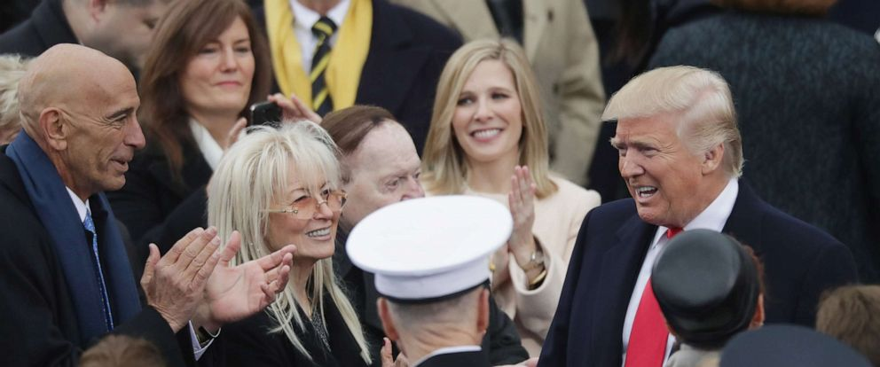 PHOTO: Tom Barrack, Miriam Adelson and Sheldon Adelson greet U.S. President-elect Donald Trump on the West Front of the U.S. Capitol on January 20, 2017, in Washington, D.C.