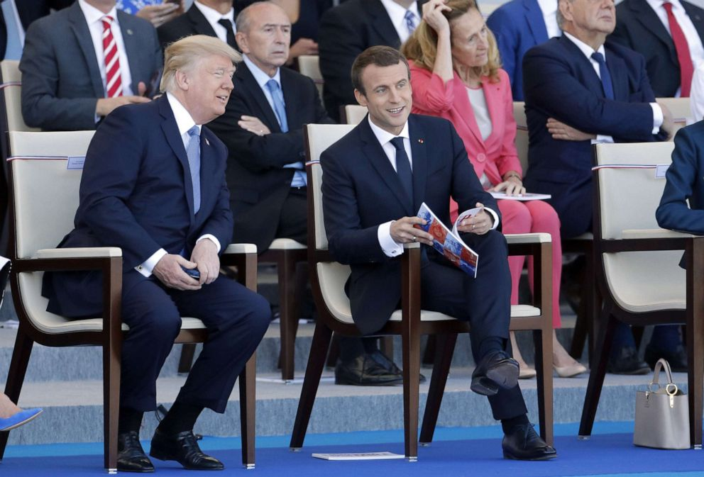 PHOTO: President Donald Trump and French President Emmanuel Macron attend the Bastille Day military parade on July 14, 2017, in Paris.