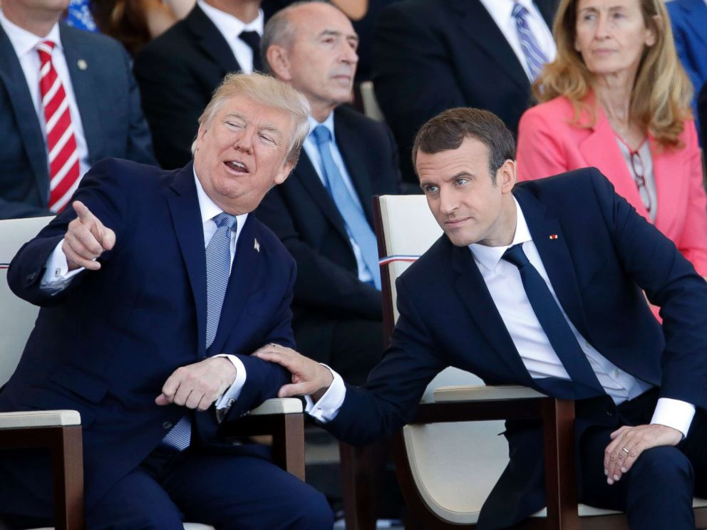 PHOTO: President Donald Trump and French President Emmanuel Macron attend the traditional Bastille day military parade on the Champs-Elysees on July 14, 2017 in Paris.