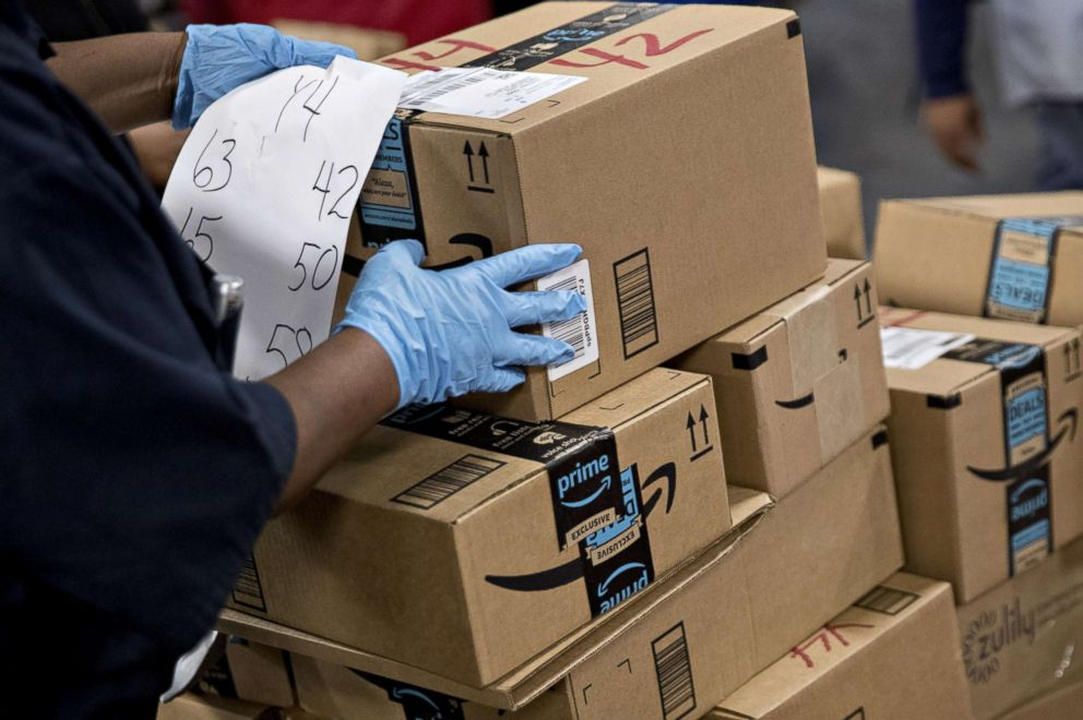 PHOTO: An employee arranges Amazon.com Inc. packages before delivery at the United States Postal Service processing and distribution center in Washington, D.C., Dec. 12, 2017.
