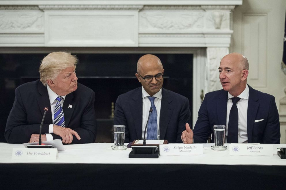 PHOTO: Jeff Bezos, far right, speaks as President Donald Trump, left, and Satya Nadella, chief executive officer of Microsoft Corp., listen during the American Technology Council roundtable hosted at the White House, June 19, 2017.