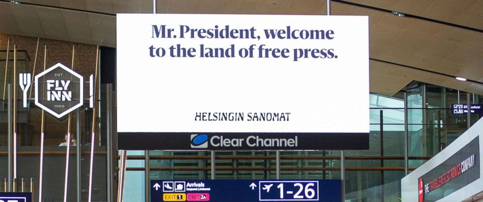 PHOTO: A billboard is posted at the airport in Helsinki along President Donald Trumps route to a meeting with Russias President Vladimr Putin.