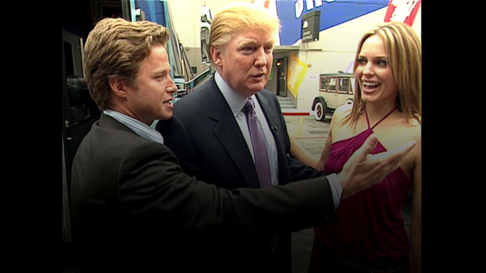 """This still grab from a 2005 video shows Donald Trump, center, accompanied by """"Access Hollywood"""" host Billy Bush, left, to the set of the soap opera """"Days of Our Lives"""" with actress Arianne Zucker for an appearance on the show."""