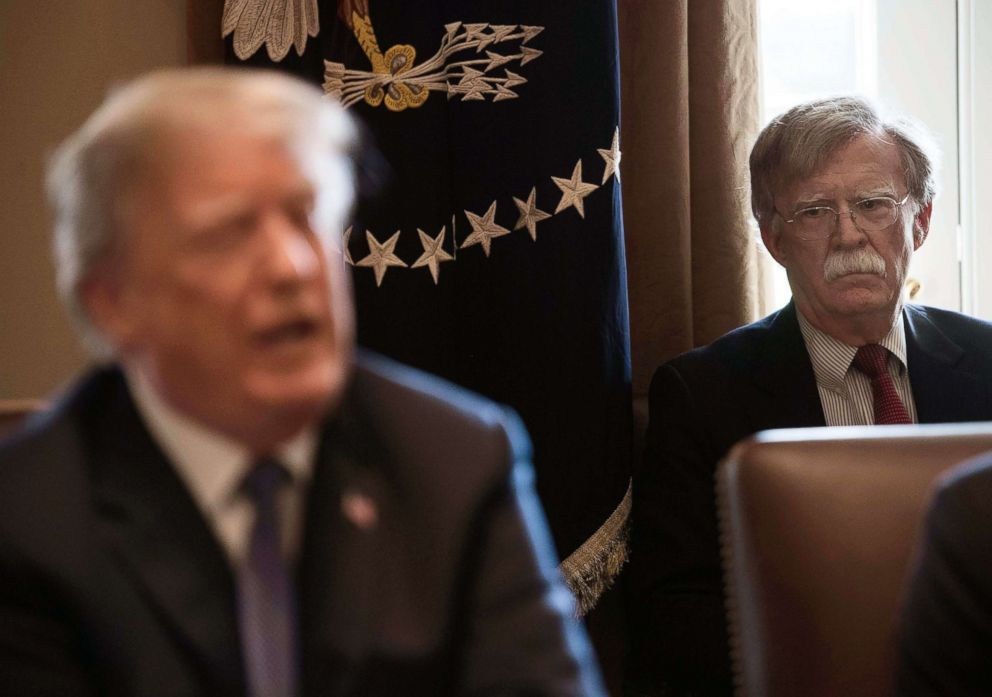 PHOTO: New National Security Adviser John Bolton, right, listens to President Donald Trump speak during a cabinet meeting at the White House in Washington, D.C., on April 9, 2018.
