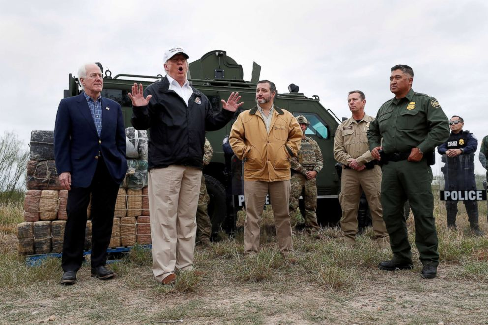 PHOTO: President Donald Trump speaks to reporters along the banks of the Rio Grande River during a visit to the U.S.-Mexico border with Sen. John Cornyn, Sen. Ted Cruz and U.S. Customs and Border Patrol agents, Jan. 10, 2019, in Mission, Texas.
