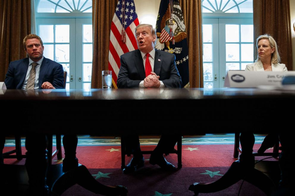 PHOTO: Timothy Ballard, CEO of Operation Underground Railroad and Secretary of Homeland Security Kirstjen Nielsen listen as President Trump speaks during an event on human trafficking in the Cabinet Room of the White House, Feb. 1, 2019, in Washington.