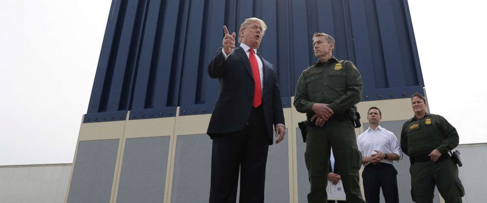 PHOTO: President Donald Trump speaks during a tour to review border wall prototypes, March 13, 2018, in San Diego, as Rodney Scott, the Border Patrols San Diego sector chief, listens.