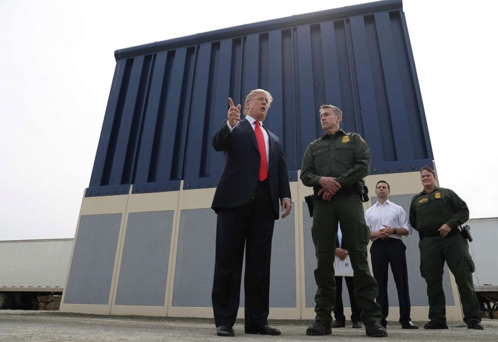 PHOTO: President Donald Trump speaks during a tour to review border wall prototypes in San Diego, as Rodney Scott, the Border Patrols San Diego sector chief, listens, March 13, 2018.