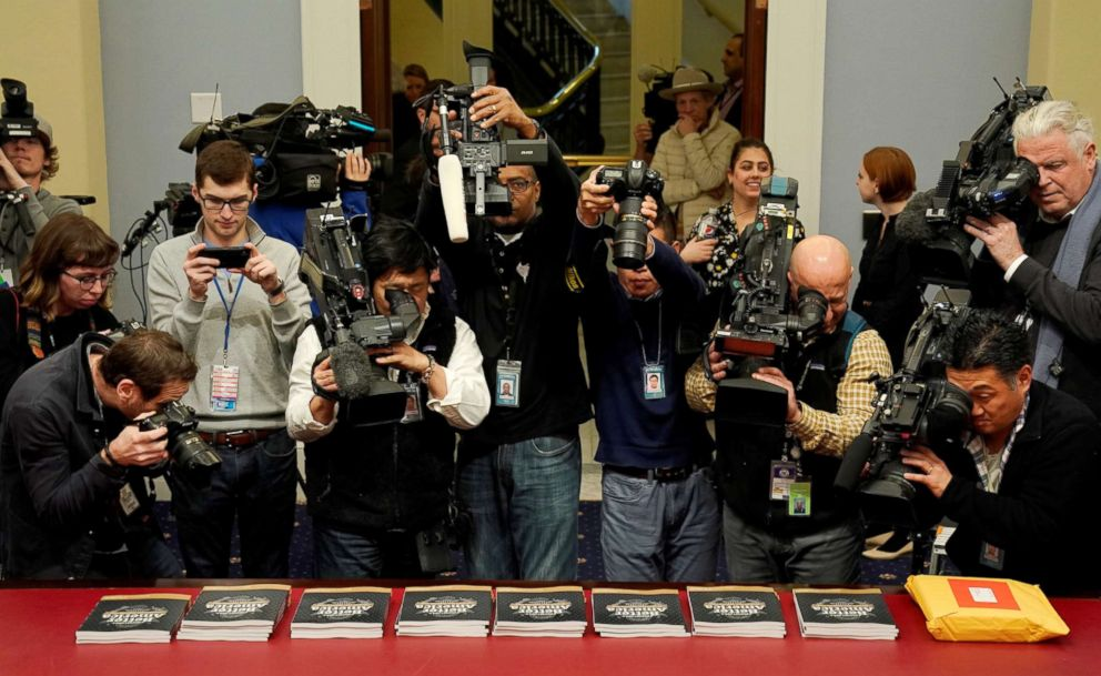 PHOTO: Members of the media point their cameras at copies of Volume 1 of U.S. President Donald Trumps budget for Fiscal Year 2020 in Washington.