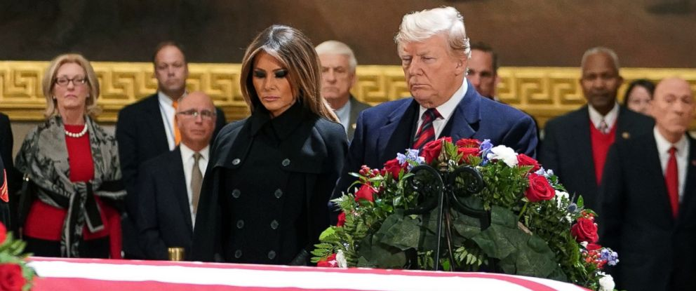 PHOTO: President Donald Trump and first lady Melania Trump pay their respects as former president George H. W. Bush lies in state in the Rotunda of the US Capitol in Washington, Dec. 3, 2018.