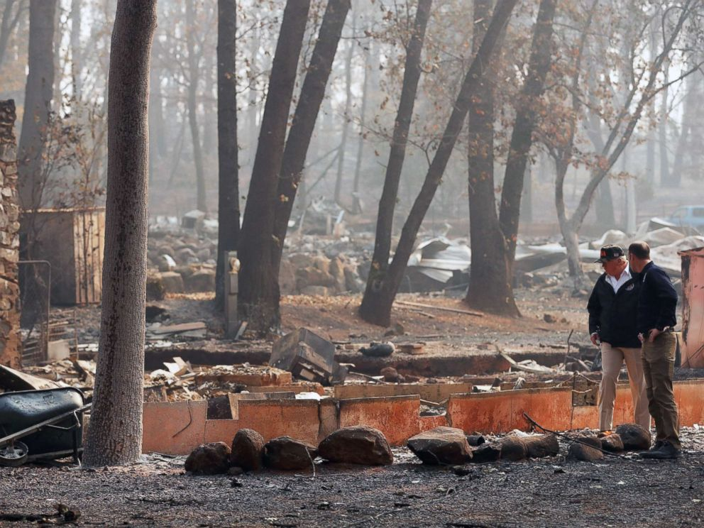 PHOTO: President Donald Trump visits the charred wreckage of Skyway Villa Mobile Home and RV Park with FEMA head Brock Long, right, in Paradise, Calif., Nov. 17, 2018.
