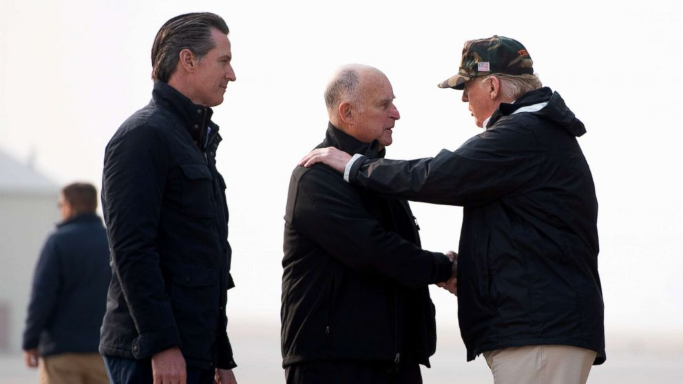 President Donald Trump greets California Governor Jerry Brown and Governor-elect Gavin Newsom, left, as he arrives at Beale Air Force Base in California, Nov. 17, 2018.