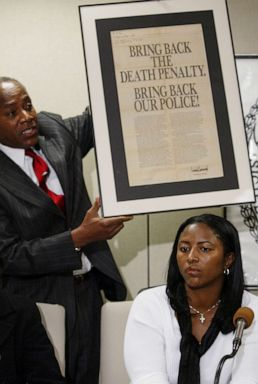 PHOTO: On Dec. 19, 2002, Angela Cuffie meets reporters at Manhattan Supreme Court and Councilman Bill Perkin s holds up an advertisement taken out by Donald Trump after the crime.
