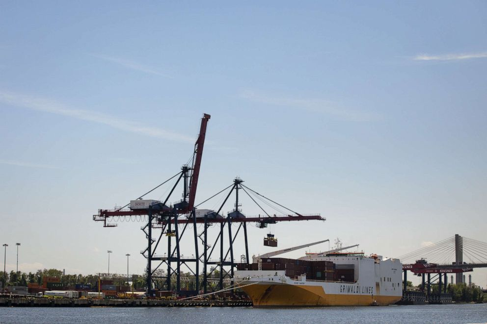PHOTO: A shipping container is loaded onto a cargo ship at the New York Container Terminal in Staten Island, May 7, 2019.