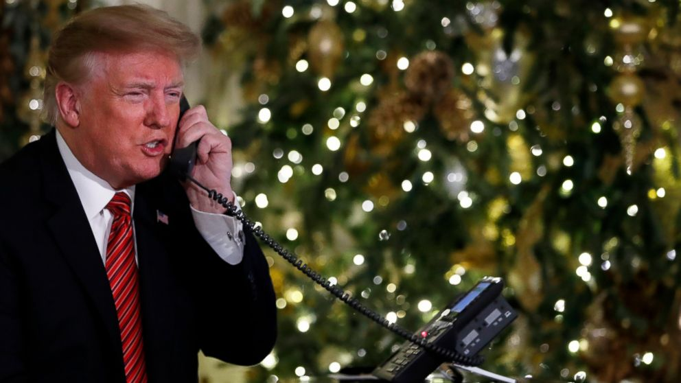 President Donald Trump speaks on the phone sharing updates to track Santa's movements from the North American Aerospace Defense Command (NORAD) Santa Tracker on Christmas Eve, Monday, Dec. 24, 2018.