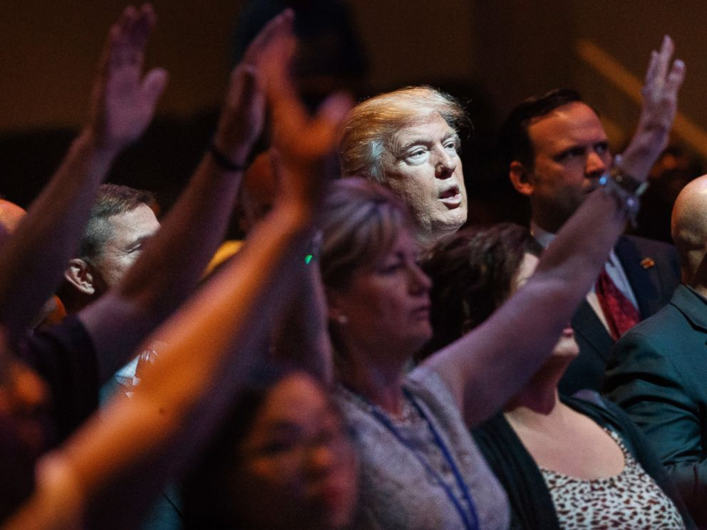 In this Oct. 30, 2016, file photo, Republican presidential candidate Donald Trump stands during a service at the International Church of Las Vegas in Las Vegas.