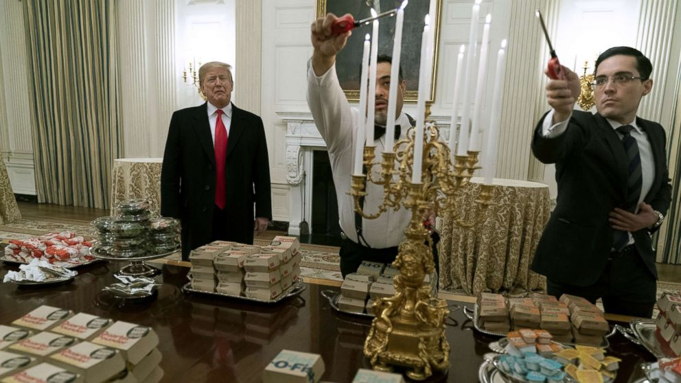 President Donald Trump presents fast food to be served to the Clemson Tigers in celebration of their national championship at the White House, Jan. 14, 2019.