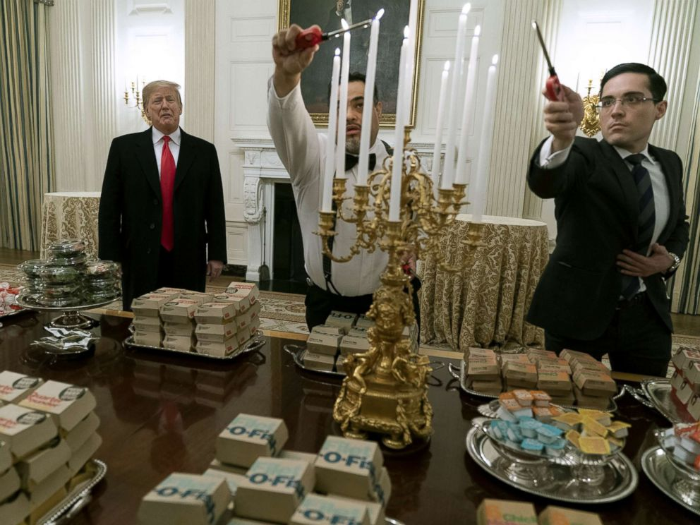 PHOTO: President Donald Trump presents fast food to be served to the Clemson Tigers in celebration of their national championship at the White House, Jan. 14, 2019.